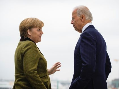 BERLIN, GERMANY - FEBRUARY 01: In this photo provided by the German Government Press Office (BPA) German Chancellor Angela Merkel (L) speaks with US Vice President Joe Biden at the start of their meeting at the Chancellery on February 01, 2013 in in Berlin, Germany. The Munich Security Conference is …
