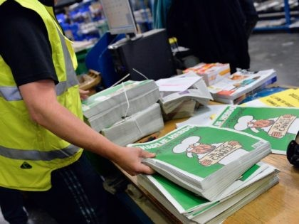 MARNE-LA-VALLEE, FRANCE - JANUARY 14: A worker prepares the new edition of Charlie Hebdo for delivery in a press distribution center in the suburbs on January 14, 2014 in Marne-la-Vallee, France. Three million copies of the controversial magazine have been printed in the wake of last week's terrorist attacks. A …