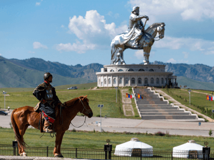 A mongolian knight stands on his horse in front of the Genghis Khan equestrian statue (the world's largest equestrian statue) in Tsonjin Boldog near Erdenet and Ulan Baator in theTov province on July 16 , 2016. - The statue was designed by sculptor D. Erdenebileg and architect J. Enkhjargal and …