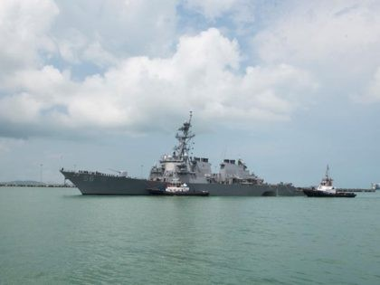 CHANGI NAVAL BASE, SINGAPORE: In this released U.S. Navy handout, tugboats from Singapore assist the Guided-missile destroyer USS John S. McCain (DDG 56) at it steers towards Changi Naval Base, Republic of Singapore following a collision with the merchant vessel Alnic MC while underway east of the Straits of Malacca …