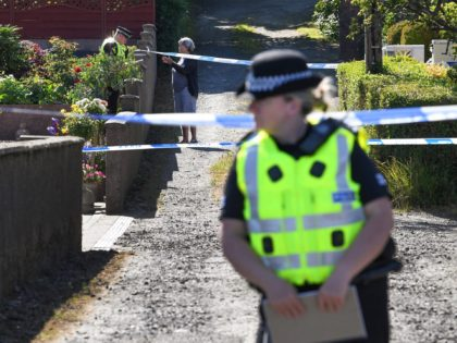 ROTHESAY, ISLE OF BUTE, SCOTLAND - JULY 02: Police stand next to a cordoned of house on Ardbeg Road, near to where the body of a six year old girl was found on July 2, 2018 in Bute, Scotland. The body was discovered this morning in the grounds of a …