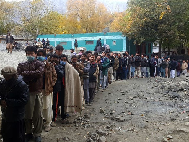 People queue to cast their ballot at a polling station during the legislative assembly election in Skardu city in Gilgit-Baltistan region of Pakistan on November 15, 2020. (Photo by Syed Mehdi SHAH / AFP) (Photo by SYED MEHDI SHAH/AFP via Getty Images)