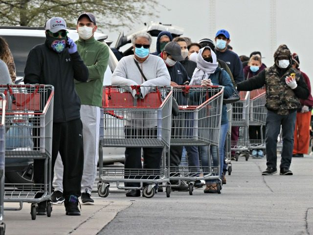 WHEATON, MARYLAND - APRIL 16: Customers wear face masks to prevent the spread of the novel coronavirus as they line up to enter a Costco Wholesale store April 16, 2020 in Wheaton, Maryland. Maryland Governor Larry Hogan ordered that all people must wear some kind of face mask to protect …