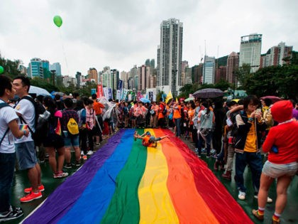People gather at Victoria Park ahead the Gay Pride Parade in Hong Kong on November 8 2014. The atmosphere was jovial as nearly two thousand people, some wrapped in rainbow-coloured flags and some dressed in drag took to the streets in Hong Kong's Gay Pride parade AFP PHOTO / XAUME …