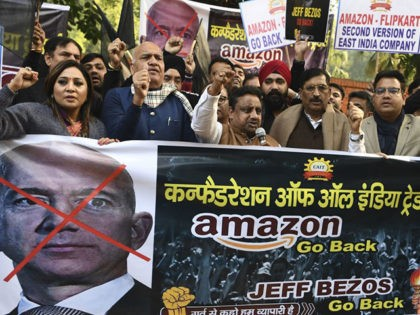 Traders hold placards during a demonstration demanding the closure of online shopping platforms Amazon and Flipkart, in New Delhi on January 15, 2020. - Bezos, whose worth has been estimated at more than $110 billion, is officially in India for a meeting of business leaders in New Delhi. (Photo by …