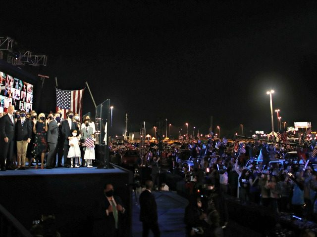 WILMINGTON, DELAWARE - NOVEMBER 07: President-elect Joe Biden and Vice President-elect Kamala Harris and their families watch fireworks from stage after Biden's address to the nation from the Chase Center November 07, 2020 in Wilmington, Delaware. After four days of counting the high volume of mail-in ballots in key battleground …