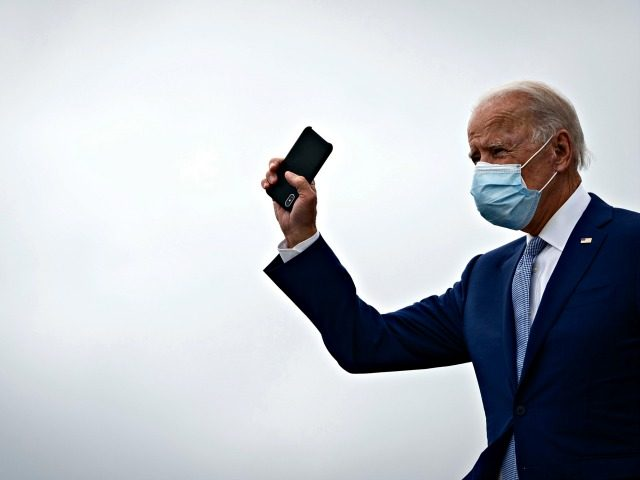 ATLANTA, GA - OCTOBER 27: Democratic presidential nominee Joe Biden holds his phone as he arrives at Atlanta International Airport on October 27, 2020 in Atlanta, Georgia. Biden is campaigning in Georgia on Tuesday, with scheduled stops in Atlanta and Warm Springs. (Photo by Drew Angerer/Getty Images)