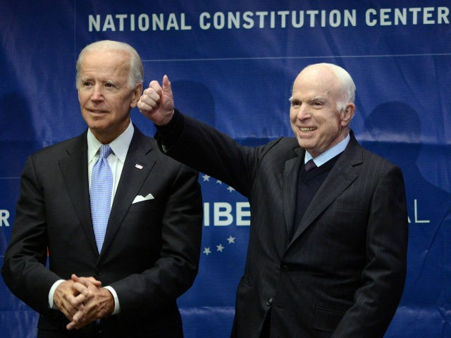 Sen. John McCain (R-AZ) give a thumbs up before receiving the the 2017 Liberty Medal from former Vice President Joe Biden (left) at the National Constitution Center on October 16, 2017 in Philadelphia, Pennsylvania. (Photo by William Thomas Cain/Getty Images)