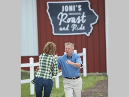 BOONE, IA - JUNE 06: Republican presidential hopeful former business executive Carly Fiorina (L) greets fellow 2016 presidential hopeful Senator Lindsey Graham (R-SC) at a Roast and Ride event hosted by freshman Senator Joni Ernst (R-IA) on June 6, 2015 in Boone, Iowa. Ernst is hoping the event, which featured …