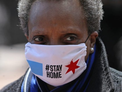 Chicago mayor Lori Lightfoot arrives at Wrigley Field on April 16, 2020 in Chicago Illinois. Wrigley Field has been converted to a temporary satellite food packing and distribution center in cooperation with the Lakeville Food Pantry to support ongoing relief efforts underway in the city as a result of the …