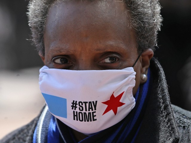 Chicago mayor Lori Lightfoot arrives at Wrigley Field on April 16, 2020 in Chicago Illinois. Wrigley Field has been converted to a temporary satellite food packing and distribution center in cooperation with the Lakeville Food Pantry to support ongoing relief efforts underway in the city as a result of the COVID-19 pandemic. (Photo by Jonathan Daniel/Getty Images)