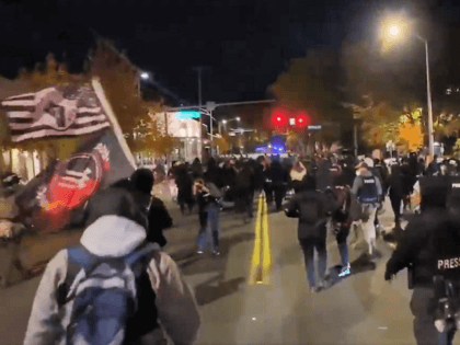 Marchers take the streets of a Portland suburb. (Twitter Video Screenshot)
