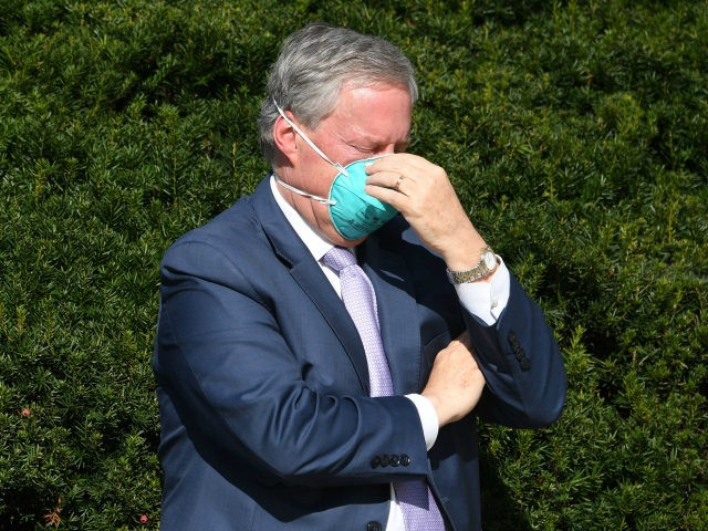 White House Chief of Staff Mark Meadows adjusts his mask as doctors update the press on the condition of US President Donald Trump, on October 5, 2020, at Walter Reed Medical Center in Bethesda, Maryland. - President Donald Trump announced that he is leaving the hospital where he was given …