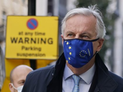 EU chief negotiator Michel Barnier wearing a face mask because of the novel coronavirus pandemic leaves a conference centre as talks continue between the EU and the UK in London on November 12, 2020. - The European Union and Britain said major divergences remain but that post-Brexit negotiations would continue …