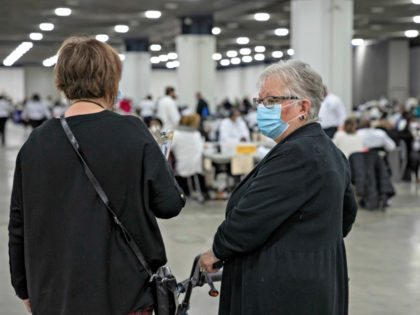 DETROIT, MI - NOVEMBER 02: Two poll watchers scan the Central Counting Board room in the TCF Center while workers with the Detroit Department of Elections sort through absentee ballots on November 2, 2020 in Detroit, Michigan. With record-breaking early voting turnout, Americans will head to the polls tomorrow for …