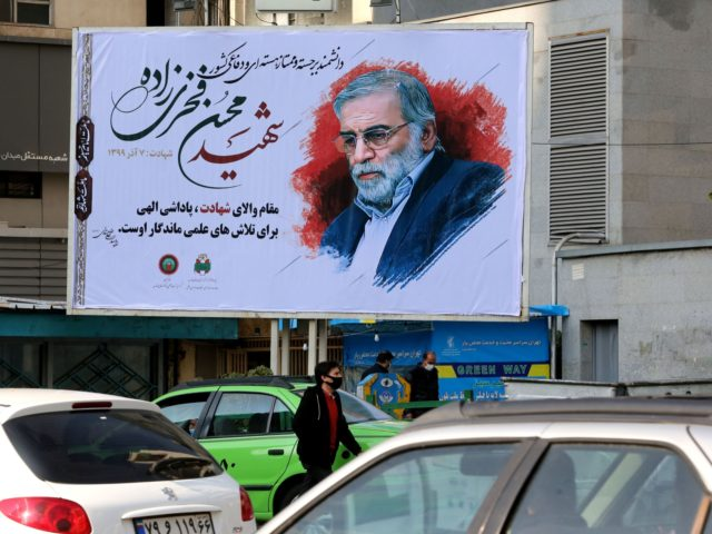 "Vehicles drive by a billboard in honour of slain nuclear scientist Mohsen Fakhrizadeh in the Iranian capital Tehran, on November 30, 2020. - Iran laid to rest a nuclear scientist in a funeral befitting a top ""martyr"", vowing to redouble his work after an assassination pinned on arch-foe Israel. Fakhrizadeh …"