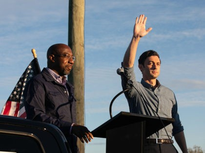 MARIETTA, GA - NOVEMBER 15: Democratic U.S. Senate candidates Jon Ossoff (R) and Raphael Warnock (L) of Georgia acknowledge supporters during a rally on November 15, 2020 in Marietta, Georgia. Ossoff and Warnock face incumbent U.S. Sens. David Purdue (R-GA) and Kelly Loeffler (R-GA) respectively in a runoff election January …