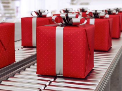 Red gift boxes on conveyor belt in time for christmas