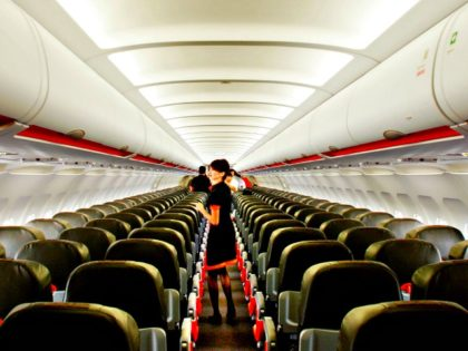 A flight attendant walks the aisle of a new Jetstar Asia Airbus A320 Wednesday, Nov. 10, 2004 in Singapore. Jetstar Asia, a Quantas venture, which had its first plane delivered today is the newest entrant to the region's already crowded budget airline market.(AP Photo/Ed Wray)