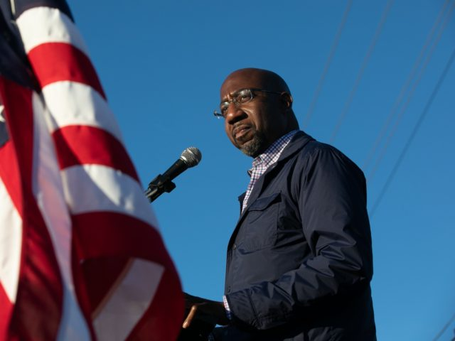 MARIETTA, GA - NOVEMBER 15: Democratic U.S. Senate candidate Raphael Warnock of Georgia speaks to supporters during a rally on November 15, 2020 in Marietta, Georgia. Warnock faces incumbent U.S. Sen. Kelly Loeffler (R-GA) in one of two January 5 runoffs for the U.S. Senate in Georgia. (Photo by Jessica …