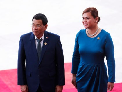 Philippine President Rodrigo Duterte (L) and his daughter Sara Duterte arrive for the opening of the Boao Forum for Asia (BFA) Annual Conference 2018 in Boao, south China's Hainan province on April 10, 2018. The BFA annual conference 2018 takes place between April 8-11. / AFP PHOTO / - / …