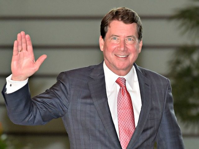 William Hagerty, the new US Ambassador to Japan, waves to the media upon his arrival at the prime minister's official residence to meet with Japan's Prime Minister Shinzo Abe in Tokyo on August 18, 2017. / AFP PHOTO / POOL / KAZUHIRO NOGI (Photo credit should read KAZUHIRO NOGI/AFP via …