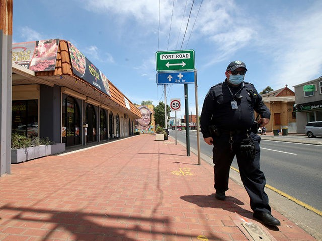 ADELAIDE, AUSTRALIA - NOVEMBER 20: Police outside the Woodville Pizza Bar after it was announced the a worker from the shop lied to authorities during a Covid investigation, causing South Australia to go into lock down on November 20, 2020 in Adelaide, Australia. South Australian premier Steven Marshall has imposed …