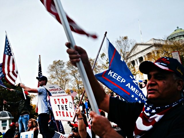 HARRISBURG, PENNSYLVANIA - NOVEMBER 05: Dozens of people calling for stopping the vote count in Pennsylvania due to alleged fraud against President Donald Trump gather on the steps of the State Capital on November 05, 2020 in Harrisburg, Pennsylvania. The activists, many with flags and signs for Trump, have made …