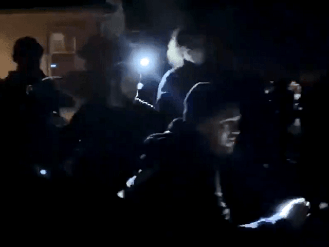 Video shows a Portland protester running away with the cell phone of a man taking video of the residential neighborhood protest. (Twitter Video Screenshot/Andy Ngo)