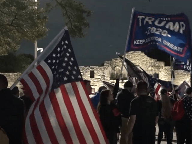Trump supporters gather outside the Alamo on November 27 in defiance of a COVID-19 curfew imposed by the mayor of San Antonio. (Video Screenshot/SBG San Antonio)