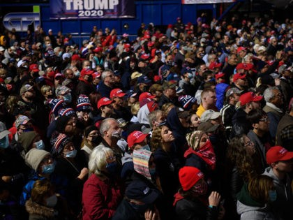 BUTLER, PA - OCTOBER 31: Supporters listen as President Donald Trump speaks at a campaign rally at Pittsburgh-Butler Regional Airport on October 31, 2020 in Butler, Pennsylvania. Donald Trump is crossing the crucial state of Pennsylvania in the last few days of campaigning before Americans go to the polls on …