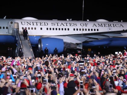 ROME, GEORGIA - NOVEMBER 01: U.S. President Donald Trump greets supporters as he walks off of Air Force One during a campaign rally at Richard B. Russell Airport on November 01, 2020 in Rome, Georgia. With two days to go until election day, Donald Trump is campaigning in Michigan, Iowa, …
