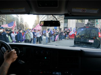 The motorcade of US President Donald Trump drives past supporters holding a rally in Washington, DC, on November 14, 2020. - Supporters are backing Trump's claim that the November 3 election was fraudulent. (Photo by MANDEL NGAN / AFP) (Photo by MANDEL NGAN/AFP via Getty Images)