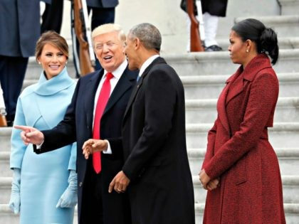 First lady Melania Trump stands as President Donald Trump and former President Barack Obama talk, with former first lady Michelle Obama, as they pause on the steps of the East Front of the U.S. Capitol as the Obamas depart, Friday, Jan. 20, 2017 in Washington. (AP Photo/Alex Brandon)