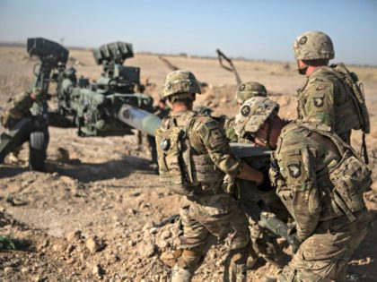 In this June 10, 2017 photo provided by Operation Resolute Support, U.S. Soldiers with Task Force Iron maneuver an M-777 howitzer, so it can be towed into position at Bost Airfield, Afghanistan. Reversing his past calls for a speedy exit, U.S. President Donald Trump recommitted the United States to the …