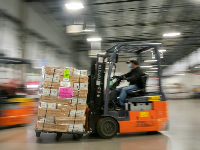 Mail handler Jimmy Tran unloads pallets filled with Washington and Oregon mail-in ballots at a U.S. Postal Service (USPS) processing and distribution center on October 14, 2020 in Portland, Oregon. USPS workers in Portland began processing and mailing about 1.5 million ballots this week ahead of the November election. (Photo …