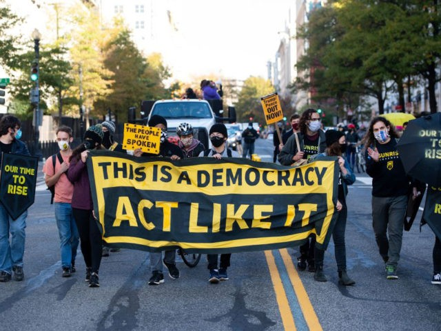 Demonstrators with ShutDown DC hold a protest to promote the counting of all votes, in Washington, DC, November 5, 2020. (Photo by SAUL LOEB / AFP) (Photo by SAUL LOEB/AFP via Getty Images)