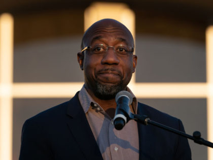 JONESBORO, GA - NOVEMBER 19: Democratic U.S. Senate candidate Raphael Warnock speaks at a campaign event on November 19, 2020 in Jonesboro, Georgia. Democratic U.S. Senate candidates Raphael Warnock and Jon Ossoff are campaigning in the state ahead of their January 5 runoff races against Sen. Kelly Loeffler (R-GA) and …