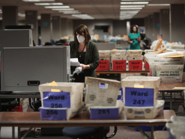MILWAUKEE, WISCONSIN - NOVEMBER 04: Claire Woodall-Vogg, executive director of the Milwaukee election commission collects the count from absentee ballots from a voting machine on November 04, 2020 in Milwaukee, Wisconsin. Wisconsin requires election officials to wait to begin counting absentee ballots until after polls open on election day. The …