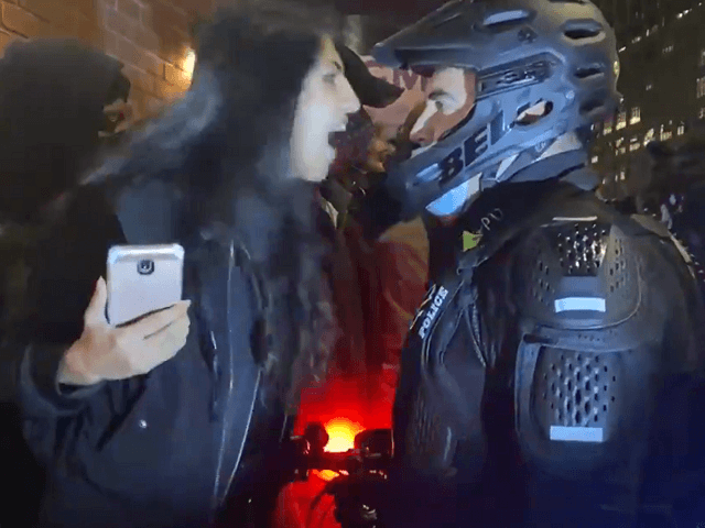 A woman is arrested after spitting in the face of an NYPD police officer during post-election protests. (Photo: Twitter Video Screenshot/Elizabeth Rosner)