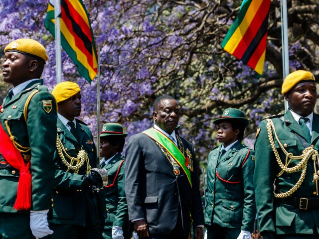 Zimbabwe's President Emmerson Mnangagwa reviews the guard of honour ahead of delivering his inaugural address at the parliament in Harare, September 18, 2018. - Mnangagwa gave his first state of the nation address following the July elections which the opposition claims to have won. (Photo by Jekesai NJIKIZANA / AFP) …