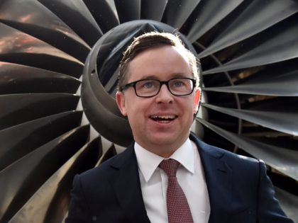 CORRECTION Qantas chief executive Alan Joyce poses for photos after a press conference in Sydney on August 20, 2015. Australia carrier Qantas roared back into the black in a stunning turnaround of fortunes driven by aggressive cost-cutting, while placing an order for eight Boeing Dreamliners. AFP PHOTO / SAEED KHAN …