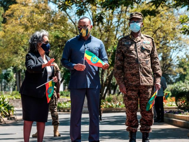 Sahle-Work Zewde (Center L), President of Ethiopia, stands next to Abiy Ahmed (Center R), Prime Minister of Ethiopia, and General Birhanu Jula (R), Chief of General Staff, stand during an event to honour the national defence forces in Addis Ababa, on November 17, 2020. - The United Nations on November …