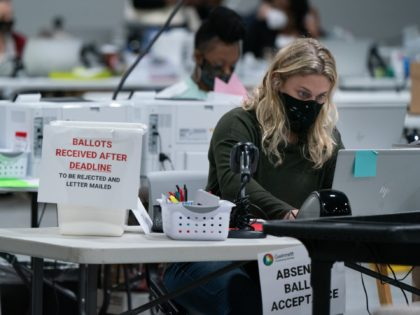 LAWRENCEVILLE, GA - NOVEMBER 07: Election personnel check in provisional ballots at the Gwinnett County Board of Voter Registrations and Elections offices on November 7, 2020 in Lawrenceville, Georgia. Several counties in Georgia continued to count ballots even as news outlets have declared Joe Biden the winner of the race …