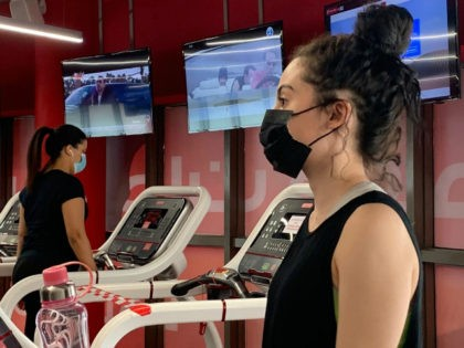 A woman, wearing a protective face mask, trains at a gym in Saudi Arabia's capital Riyadh on June 23, 2020, as the country begins to re-open following the lifting of a lockdown due to the COVID-19 coronavirus pandemic. (Photo by RANIA SANJAR / AFP) (Photo by RANIA SANJAR/AFP via Getty …
