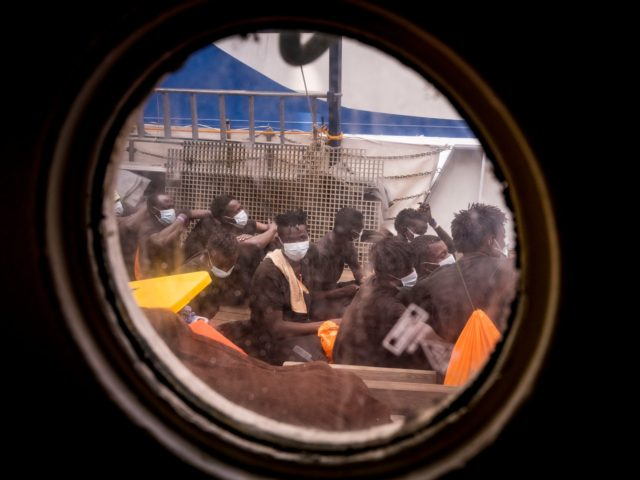 Young rescued migrants wait to leave the Sea-Watch 4 rescue boat to board a ferry on which some 350 migrants will be under quarantine, off the coast of Palermo, Sicily, Italy, on September 02, 2020. - More than 350 migrants including those rescued by a vessel sponsored by British street …