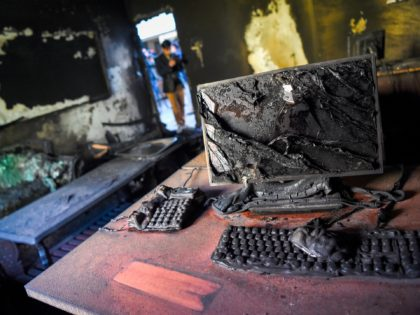 A photographer takes pictures inside a burned office of the National Legal Training center a day after gunmen stormed the university in Kabul on November 3, 2020. - Stunned students demonstrated outside Kabul University on November 3 after at least 22 people were killed in a brutal, on-campus attack claimed …