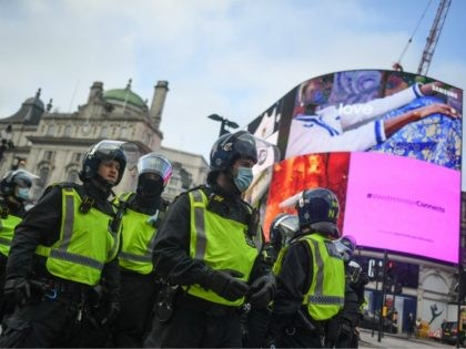 LONDON, ENGLAND - NOVEMBER 28: Police officers in riot gear are seen at Piccadilly circus during a protest on November 28, 2020 in London, England. London is to return to 'Tier 2' or 'high alert' covid-19 restrictions once the current England-wide coronavirus lockdown ends next Wednesday. All three of the …