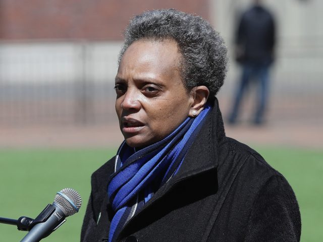 CHICAGO, ILLINOIS - APRIL 16: Chicago mayor Lori Lightfoot speaks during a press outside of Wrigley Field on April 16, 2020 in Chicago Illinois. Wrigley Field has been converted to a temporary satellite food packing and distribution center in cooperation with the Lakeville Food Pantry to support ongoing relief efforts …