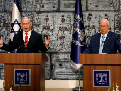 Israeli Prime Minister Benjamin Netanyahu speaks after being tasked by President Reuven Rivlin (R) with forming a new government, during a press conference in Jerusalem on September 25, 2019. - Israel's president tasked Netanyahu with forming a new government after last week's deadlocked elections, his office announced, the announcement followed …